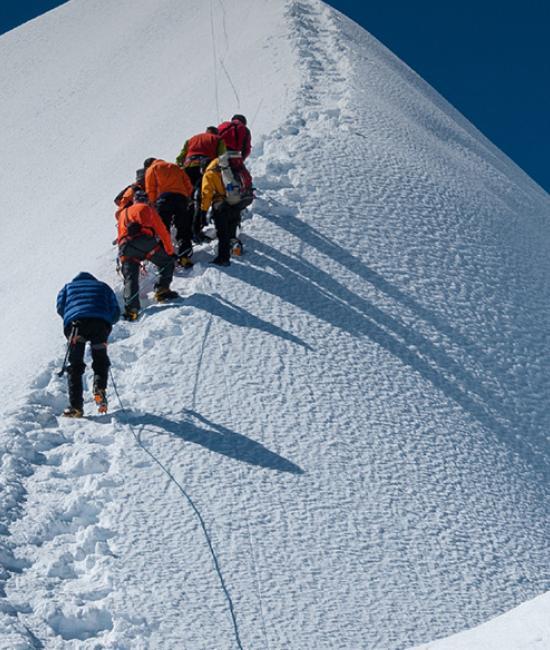 Marketing Authorisation people climbing up a snow mountain
